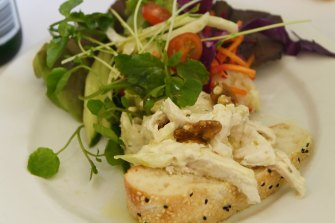 The lime marinated chicken breast and salad greens topped with walnuts.