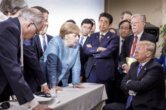 Chancellor Angela Merkel and Donald Trump with other world leaders at the G7 summit in Quebec in 2018.