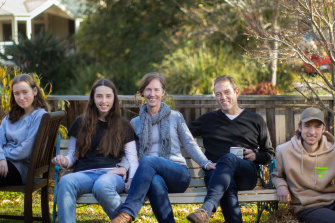 Melissa and James Thyer (centre) with their children, Ella, Alexandra and Ted.
