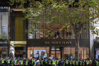 Police surround protesters outside the Victorian Liberal Party headquarters.