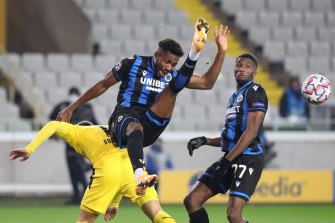 Emmanuel Dennis will miss Club Brugge's Champions League trip to Borussia Dortmund.
