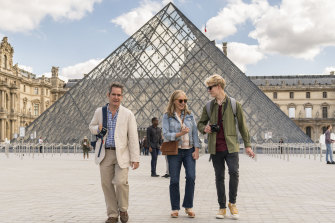 In happier times: Douglas (Tom Hollander), Connie (Saskia Reeves) and Albie (Tom Taylor) do the Louvre in Us.