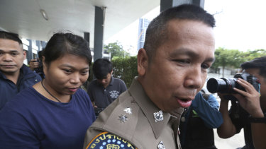 The  is led by police to a court after her arrest in Bangkok.