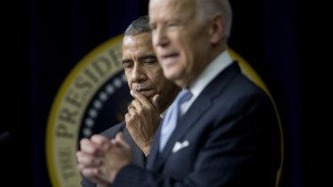 Then US President Barack Obama listens as Vice-President Joe Biden speaks in December 2016.