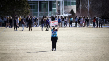 Leah Zundel holds a sign as she and other students from Columbine High participate in a walkout to honour victims of gun violence in March 2018.