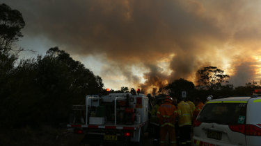 Firefighters work through night to protect homes north of Newcastle