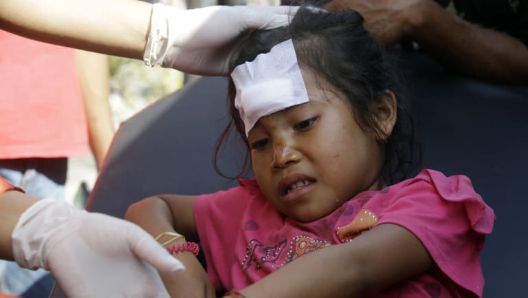 An girl injured from the earlier earthquake at Mataram, Lombok.