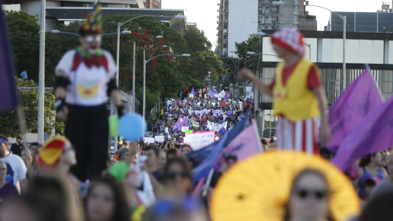Women protest femicides during a march marking the International Day for the Elimination of Violence Against Women in Asuncion, Paraguay.