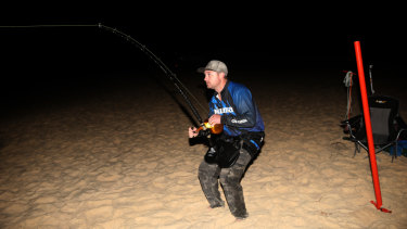 Adam Maddalena catching a bull shark, before tagging and releasing it.