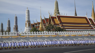Thai officers stand outside the Grand Palace in Bagkok ahead of King Maha Vajiralongkorn's coronation.