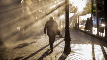 A pedestrian walks through tear gas during a protest in Santiago on Friday.