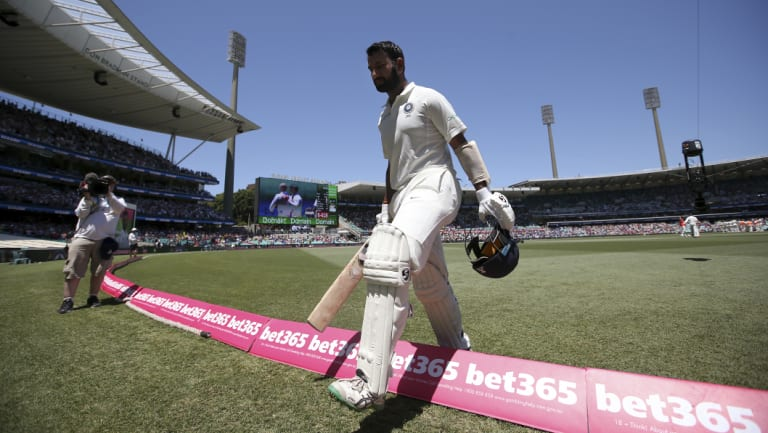 Job done: Cheteshwar Pujara walks off after his brilliant 193.