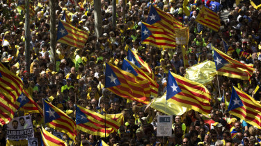 Demonstrators wave esteladas (independence flags) in Barcelona on Sunday.