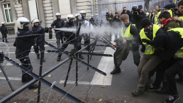 Police spray tear gas at demonstrators during a protest in Brussels on Friday.
