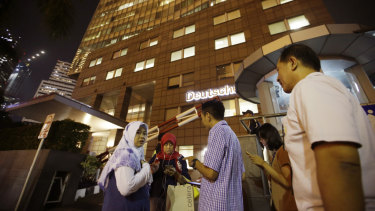 People gather as they evacuate from a building after a strong earthquake.