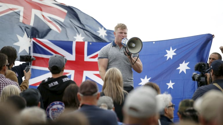 Convicted criminal and right-wing extremist Blair Cottrell addresses the rally.