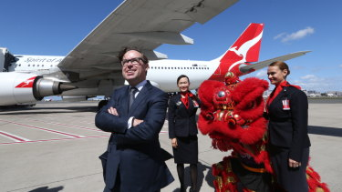 Qantas boss Alan Joyce has defended the airline's decision to remove references to Taiwan as a separate country.