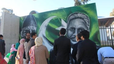 The crowd at the opening of the striking mural on the Pakistan High Commission in Canberra.