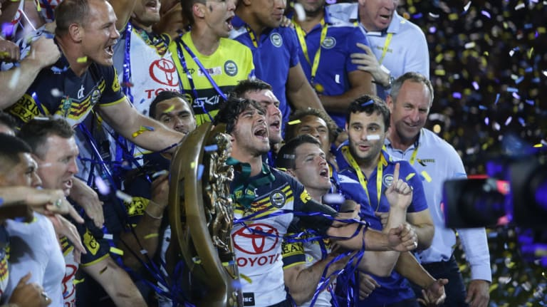 Champions: Thurston and the Cowboys celebrate their 2015 grand final win.