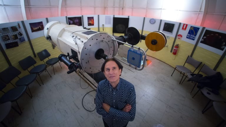 Perry Vlahos with the 18-inch optical telescope.