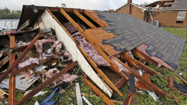 A roof that was blown off a home rests on the ground in Hamilton, Mississippi, after a deadly storm on Sunday.