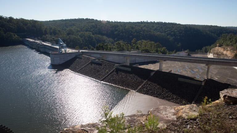 Warragamba Dam at almost 98 per cent full in June 2016. The government wants to lift the wall by 14 metres to add flood mitigation to the dam's role.
