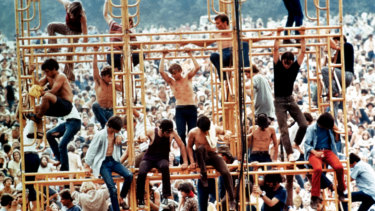 Festival goers on the sound tower scaffolding at Woodstock.