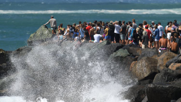Crowds of people watching the waves at Kirra on the Gold Coast on Saturday.