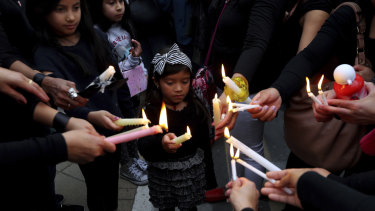 Mourners hold a vigil on Friday outside the presidential palace in Nicosia, Cyprus.
