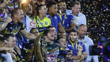 Exceptions to the rule: Johnathan Thurston and the Cowboys celebrate their 2015 grand final win.
