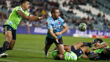 Drought-breaker: Bernard Foley offloads during the Waratahs' round 14 win over the Highlanders last year.