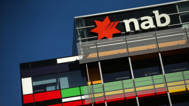 NAB's bottomline result dipped because of higher spending on investment and credit impairment charges.