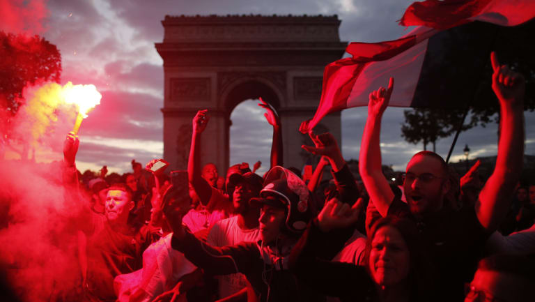 France supporters celebrate on the Champs-Elysees.