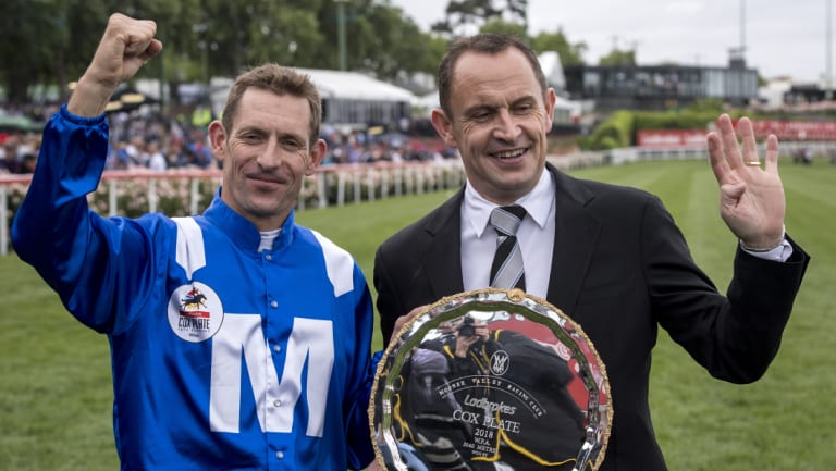 Winx jockey Hugh Bowman and  trainer Chris Waller hold the Queen of the Turf's fourth Cox Plate.