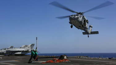 A Sea Hawk helicopter prepares to take a load on the flight deck of aircraft carrier USS Abraham Lincoln in the Persian Gulf on Friday.