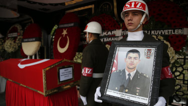Turkish soldiers stand in vigil next to the national flag-draped coffin of 24-year old Muhammed Ali Kalo during his funeral procession in Istanbul on Saturday.