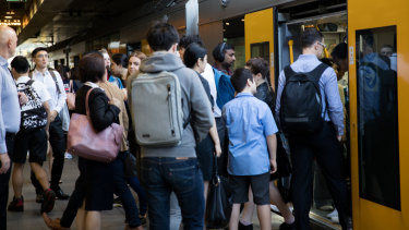 Passengers board a train at Chatswood station this week.