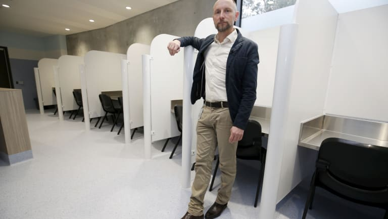 Dr Nico Clark, medical director at the injecting room, launches the centre.