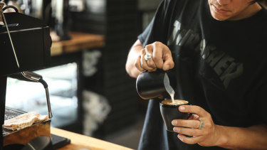 The human touch ... a barista dispenses more than coffee.