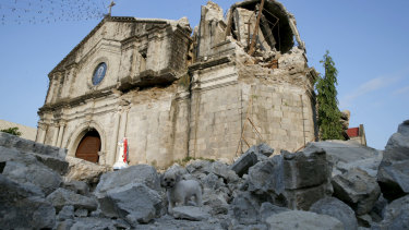 The damage of St Catherine church, with its headless statue, is seen following Monday's 6.1 magnitude earthquake in the Philippines.