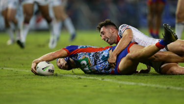 Red hot: Kalyn Ponga scores for the sixth successive match.