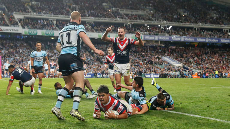 Charged: Latrell Mitchell crosses for the Roosters at Allianz Stadium.