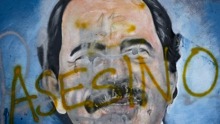 The Spanish word for 'murderer' covers a mural of Nicaragua's President Daniel Ortega, as part of anti-government protests demanding his resignation in Managua, Nicaragua..