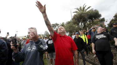 A protester issues a Nazi salute at Saturday's St Kilda rally.