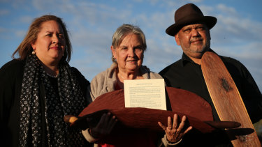 Megan Davis, Pat Anderson and Noel Pearson with a piti holding the Uluru Statement from the Heart.