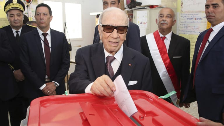 Tunisian President Beji Caid Essebsi casts his vote for city and town councils earlier this year.