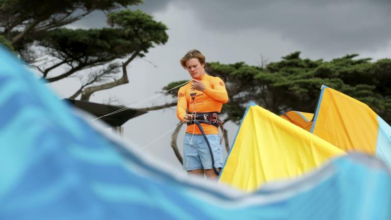 Kitesurfer James Carew prepares his equipment.
