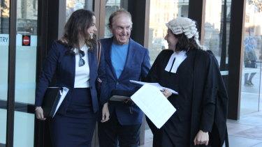 Dr John O'Neill (centre) leaves the NSW Supreme Court on Thursday.