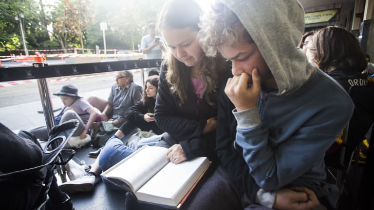 The best way to pass the time: These fans read a Harry Potter book while waiting for tickets.