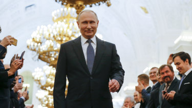 Vladimir Putin enters to take the oath during his fourth inauguration.